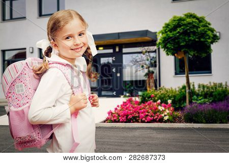 Back to school. Beatifull girl is going to school. Child in school with book and accessories. Education concept