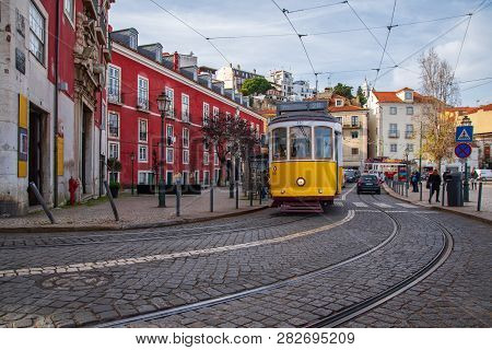 View Of Yellow Tram In Downtown Lisbon