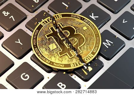 Cracked Or Damaged Bitcoin Is Laying On Keyboard. Paying Ransom With Bitcoin Concept. 3d Rendering