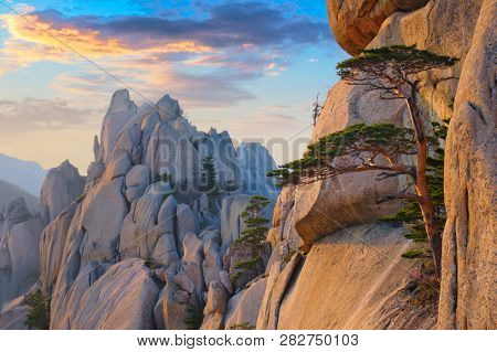 View of stones and rock formations from Ulsanbawi rock peak on sunset. Seoraksan National Park, South Corea