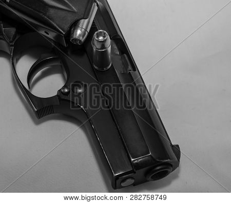 A Black 40 Caliber Pistol With A Loaded Pistol Magazine On Top Or If With A 40 Caliber Hollowpoint B
