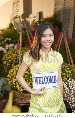 Pretty Young Asian Flower Shop Owner Inviting You To Her Store
