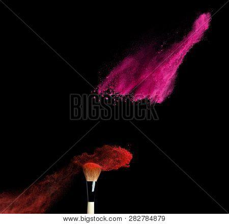 Make-up Brush With Powder Explosion Isolated On Black Background