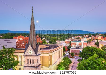 Roanoke, Virginia, USA downtown skyline and steeple at dawn.