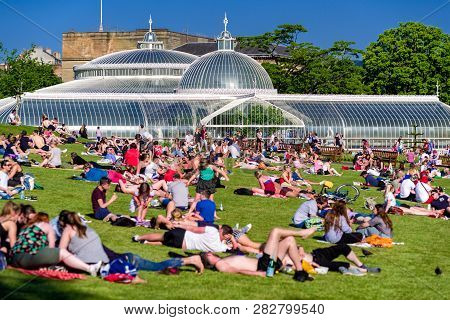 Glasgow, Scotland - May 28:  Crowded Park Of Relaxing People. Glasgow Botanic Gardens On May 28, 201