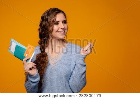 Pretty Smiling Woman Buying Tickets Online By Credit Card, Buying Tickets Online