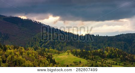 Panorama Of A Wonderful Countryside In Mountains. Meadow Among Forested Rolling Hills. Beautiful Lan