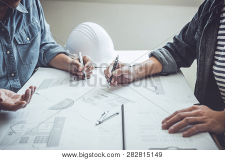 Architecture Engineer Teamwork Meeting, Drawing And Working For Architectural Project And Engineerin