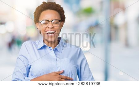 Young beautiful african american business woman over isolated background Smiling and laughing hard out loud because funny crazy joke. Happy expression.