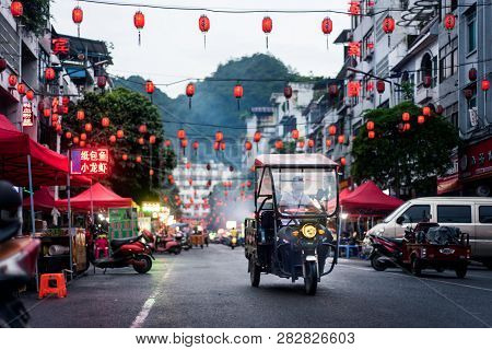 Pingxiang, China - July 3, 2018: Traditional Chinese Food Market Street Scene With People Preparing