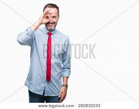 Middle age hoary senior business man wearing red tie over isolated background doing ok gesture with hand smiling, eye looking through fingers with happy face.