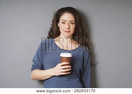 Relaxed Young Woman On Her Coffee Break - Holding Coffee To Go In Disposable Paper Cup While Leaning