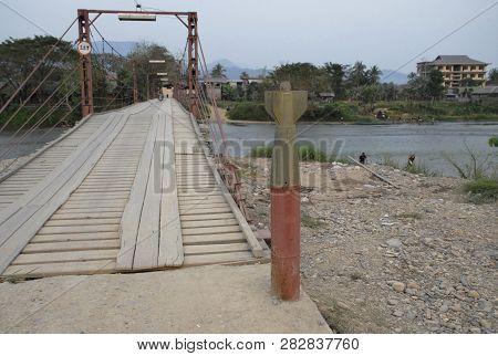 Bridge With An Empty  Bomb Casing Erected Near The End..laos,near Phonsavan