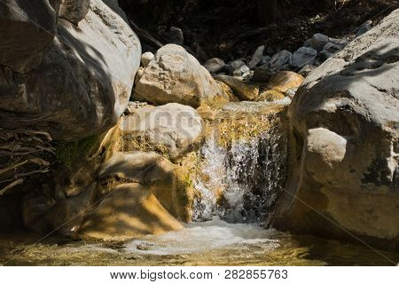 Crystal Clear Water Of A Cold Mountain Creek At Rocky Terrain Of Samaria Gorge, South West Part Of C