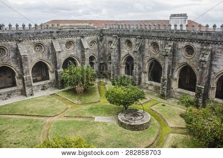 View Of The Lovely Cloister Garden From The Upper Storey Of The Cathedral Of Evora, In Portugal.