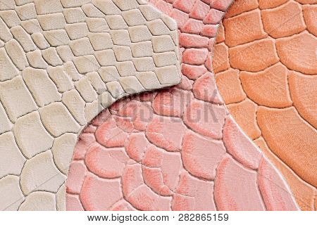 Genuine leather, colorful samples in a different colors, embossed under the skin reptile. Texture pattern for background poster