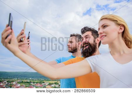 Being Narcissistic. People Enjoy Selfie Shooting On Natural Landscape. Sexy Woman And Men Holding Sm