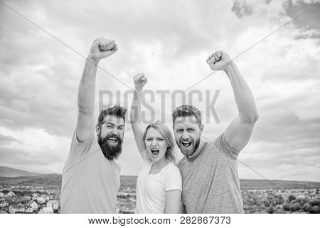 Ways to build ohesive team. Woman and men look confident successful sky background. Threesome stand happy confidently with raised fists. Behaviors of cohesive team. Celebrate success. Yes we can poster