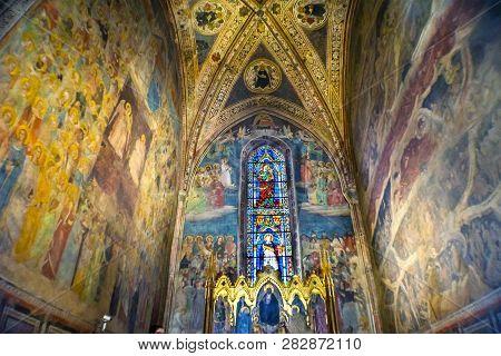 Florence, Italy - September 17, 2017 Altarpiece Redeemer Jesus Christ Frescos, Statined Glass Window