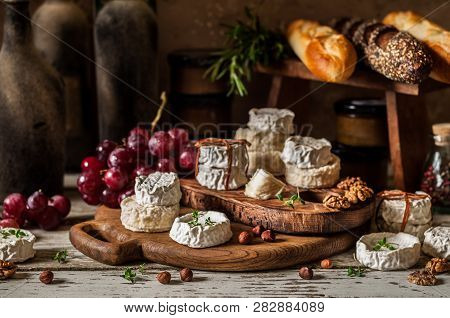 Variety Of French Cheeses And Another Provision In A Dusty Pantry