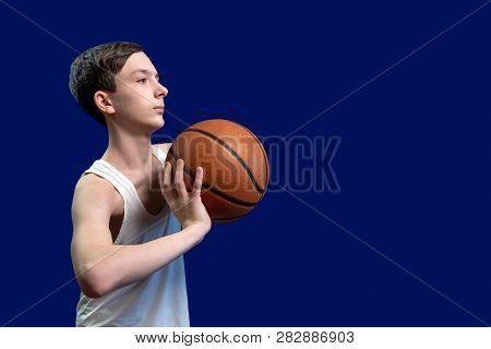Basketball And Teenager. The Guy In The White Jacket Can Throw A Ball From The Chest.template For Po