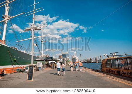 HAMBURG, GERMANY - JULY 24, 2018 :Tourists on foot Graben Hamburg,Germany.