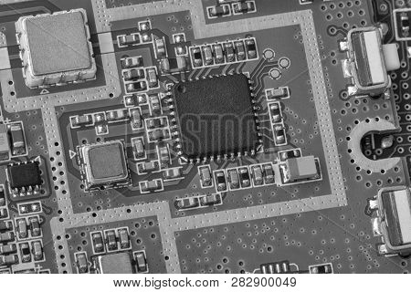 Electronic Circuit Board Close Up. Limited Depth Of Field. Black And White Image