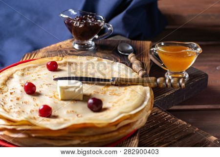 English-style Pancakes With Berries, Traditional For Shrove Tuesday. Traditional Classic Thin Golden