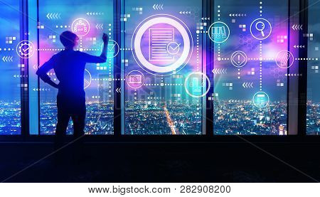 Compliance Theme With Man Writing On Large Windows High Above A Sprawling City At Night