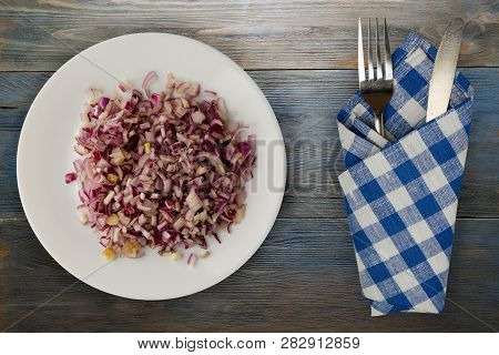Red Onion On A Wooden Background. Chopped Red Onion On A Plate