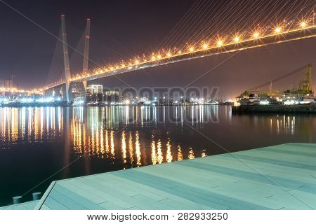 Vladivostok, Russia-february 2, 2019: Night Landscape Of The Tsarevich Embankment Overlooking The Go