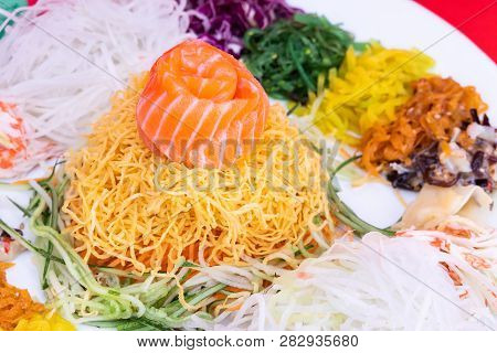 Close-up Of Yee Sang Or Yusheng With Raw Salmon Fish Believed To Bring Luck. Consume During Chinese