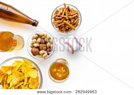 Snacks For Watching American Football On Tv. Watching Sports. Chips, Nuts, Rusks Near Beer And Ball