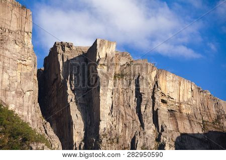 Preikestolen or Prekestolen (Preachers Pulpit, Preachers Chair or Pulpit Rock) steep cliff as seen from Lysefjord (Lysefjorden) fjord, a major tourist attraction in Forsand, Rogaland county, Norway