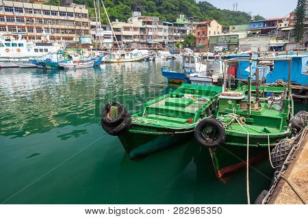 Keelung, Taiwan - September 5, 2018: Green Wooden Fishing Boats Are Moored In Fishing Harbor Of Keel