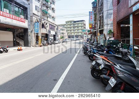 Keelung, Taiwan - September 5, 2018: Street View Of Keelung City At Day, Scooters Stand Parked On Th