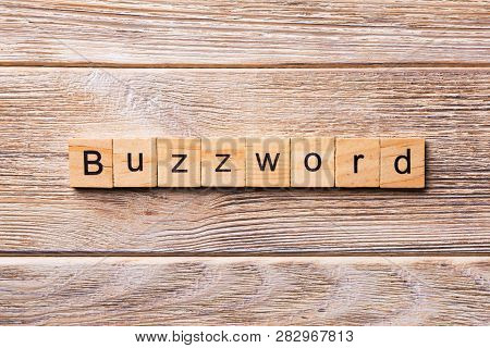Buzzword Word Written On Wood Block. Buzzword Text On Wooden Table For Your Desing, Concept