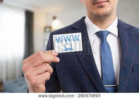 Man Advertising Business By Presenting Card With Www Letters And Laptop Symbol As Visit Our Website