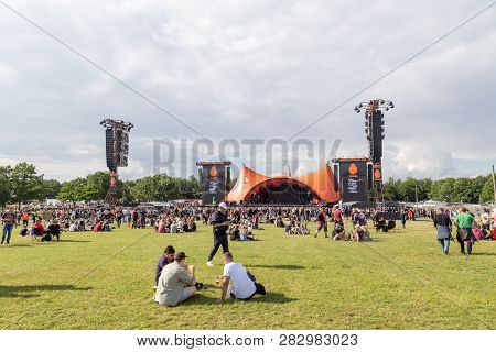 Roskilde, Denmark - June 30, 2016: Crowd Of Spectators Enjoying A Concert At The Orange Stage At Ros