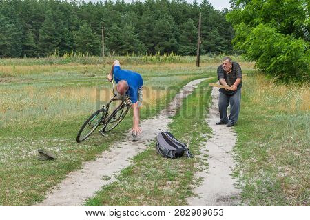 Senior Man Punishing Thief Who Driven Away An Ancient Bicycle With Club In Ukrainian Rural Area