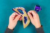 Diy Masquerade mask Mardi Gras, Fat Tuesday. Gift idea, decor Mardi Gras. Carnival mask cardboard, sequins, paper, beads. Step by step. process childrens crafts. Top view. Green yellow purple poster