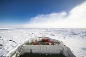 Frozen polar sea and vast ice floes from the bridge of a research icebreaker ship poster