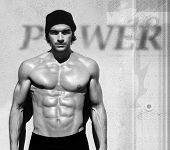Sexy fine art black and white portrait of a very muscular shirtless male model poster