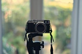 Close-up Of Retro Rangefinder-style Digital Camera On Tripod. Narrow Depth Of Field. Focus Centred O