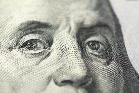 Close-up View Of 100 Dollars Note With Benjamin Franklin Face