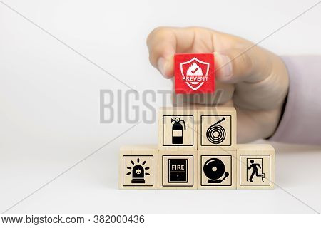 Close-up Hand Choose Fire Prevent Icon On Cube Wooden Toy Blocks Stacked With Fire Prevention Icon F