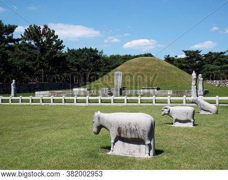 Gimhae, Busan, South Korea, September 1, 2017: Tomb Of King Suro With Animal Sculptures Around It. L