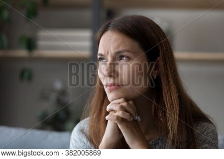 Anxious Young Woman Look In Distance Pondering Of Problems
