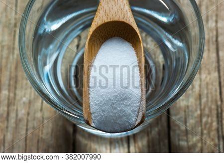 Carbonate Powder Or Baking Soda And Glass Of Water On Wooden Table, Alternative Medicine, Organic Cl