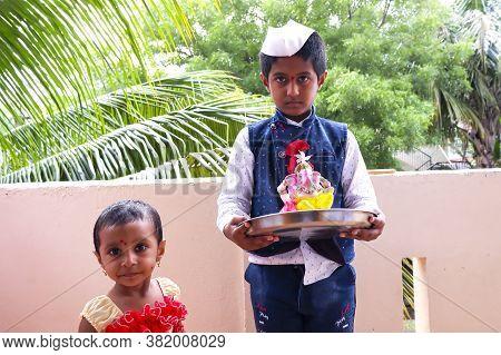 Kalaburagi, Karnataka/india-august 22.2020: Children's Bringing The Ganesha Idol To Home For Ganesha